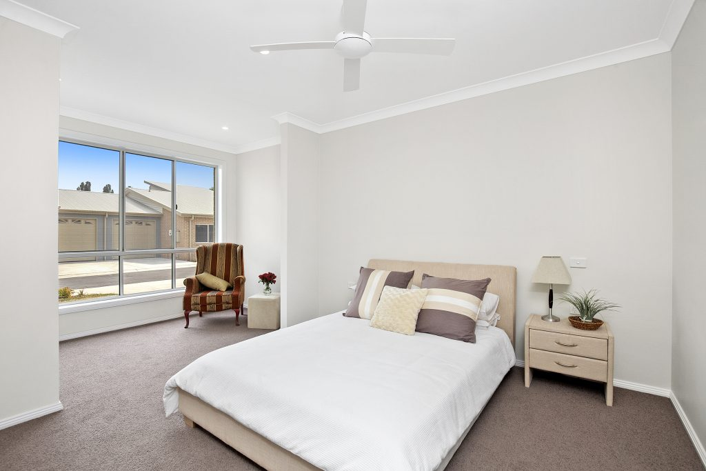 Wonderfully appointed master bedroom with additional sun room at the front